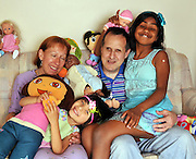 "Jun 17, 2011 - Chicago, Illinois, USA - EXCLUSIVE<br /> <br /> Blind Couple Adopt Blind Children<br /> <br /> RAISING two kids is hard enough – but imagine if both parents are blind…and they adopt two blind children.<br /> Paula and Alan Sprecher did – and say it's the best decision they've ever made!<br /> ""We face challenges all day long – but we always find ways to overcome them,"" said loving mum Paula, 49, a teacher for the visually impaired.<br /> ""Alan  and I have been legally blind since birth, so we know how to teach our kids survival skills that make them confident and independent young people.<br /> ""All four of us are lucky. We feel blessed!""<br /> Paula and Alan were married for 21 years before a chance encounter with two nuns collecting money for overseas orphanages led them to Rupa, then seven years old and living in an orphan in Bangalore, India.<br /> ""Adoption officials told us that all the little girl dreamed of was having a mom and dad,"" said Paula.<br /> ""Her favorite childhood game was to play like she was talking to her mother and father.""<br /> Despite initial doubts about parenthood – do we have enough to offer a child? – the couple could not resist adopting the little girl who loves dolls, frilly dresses and bangles. That was in 2008.<br /> Then they found Aihua, four years younger, in China. She's a tomboy who loves blocks and puzzles and sleeps with a yellow toy Jeep.<br /> Now they live in a two-story brick house in Chicago where the microwave buttons are marked with Braille, the clocks announce the time and everyone listens for the school bus at 7.15 a.m.<br /> ""We grew up without sight,"" said Paula. ""It's normal to us. We knew there were kids out there who were probably abandoned because they were blind and we wanted to provide a home for them – children we knew we could help.""<br /> The Sprechers teach their girls how to ride the bus (listen carefully for each stop), how to identify coins by size and weight (""This is a dime!"" Aihua says correctly), how to sort the laundry (pin your sock"