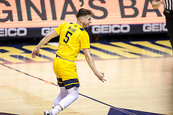 Feb 12, 2020; Morgantown, West Virginia, USA; West Virginia Mountaineers guard Jordan McCabe (5) celebrates after a three pointer during the first half against the Kansas Jayhawks at WVU Coliseum. Mandatory Credit: Ben Queen-USA TODAY Sports