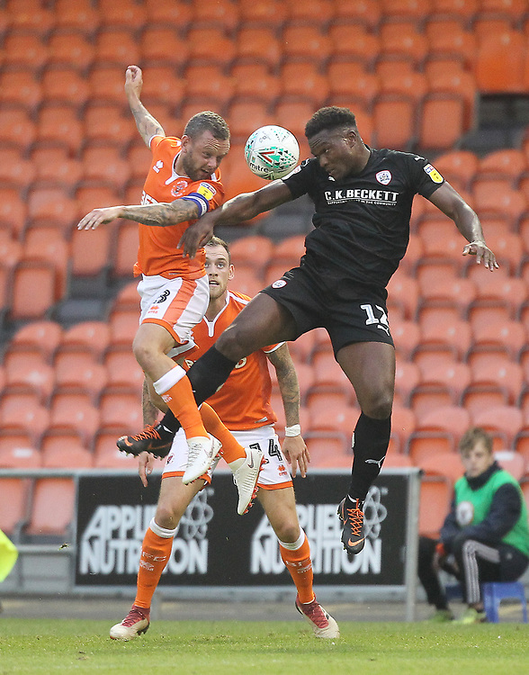 Blackpool's Jay Spearing  battles with Barnsley's Dimitri Cavaré<br /> <br /> Photographer Mick Walker/CameraSport<br /> <br /> Carabao Cup First Round - Blackpool v Barnsley - Tuesday August 14th 2018 - Bloomfield Road - Blackpool<br />  <br /> World Copyright © 2018 CameraSport. All rights reserved. 43 Linden Ave. Countesthorpe. Leicester. England. LE8 5PG - Tel: +44 (0) 116 277 4147 - admin@camerasport.com - www.camerasport.com