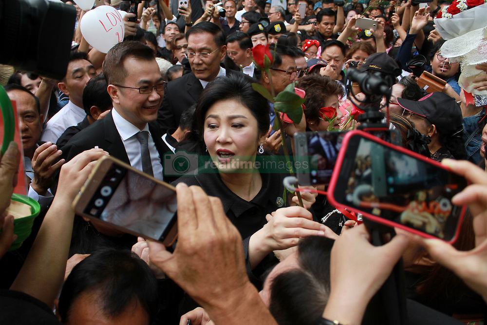 July 21, 2017 - Bangkok, Thailand - Former Thai Prime Minister YINGLUCK SHINAWATRA greets supporters as she arrives at the Supreme Court in Bangkok during a final court hearing expected in the negligence trial of ousted Yingluck, who faces up to a decade in jail in a case lambasted by her supporters as politically motivated. (Credit Image: © Vichan Poti/Pacific Press via ZUMA Wire)