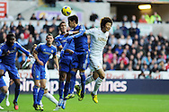 Chelsea's Oscar (11) wins a header from Swansea's Ki Sung-Yueng ®.  Barclays Premier league, Swansea city v Chelsea at the Liberty Stadium in Swansea, Swansea, South Wales on Saturday 3rd November 2012. pic by Andrew Orchard, Andrew Orchard sports photography,