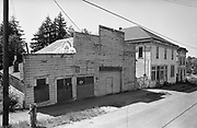 Y-680604-A11.  Three Buildings in Aurora, 1968. Left building: Nagle's Garage, 108 Main St. (a shoemaker operated out of the left side of the building). Middle building: Top floor, hotel, bottom floor, Aurora Colony Grocery, 126 Main St. Right building: Aurora Post Office. Aurora, Oregon. June 4, 1968
