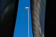 A street lamp seen between ramps of an expressway overpass in Nihonbashi, Tokyo, Japan. Thursday September 15th 2011