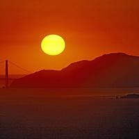 San Francisco, California. Sunset over the Golden Gate Bridge.