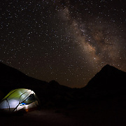 Backpackers prepare for a night beneath starry skies in the Royce Lakes Basin.
