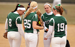 30 March 2013:  Infielders (Emma Clark, Courtney Martin, Chloe Montgomery, Hannah Bowen and Molly McCready) huddle near the pitchers mound just before the play of the inning commences during an NCAA Division III women's softball game between the DePauw Tigers and the Illinois Wesleyan Titans in Bloomington IL