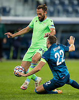 SAINT PETERSBURG, RUSSIA - NOVEMBER 04: Artem Dzyuba of Zenit St Petersburg is dispossessed by Cedat Muriqi  of SS Lazio during the UEFA Champions League Group F stage match between Zenit St. Petersburg and SS Lazio at Gazprom Arena on November 4, 2020 in Saint Petersburg, Russia. (Photo by MB Media)