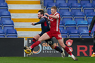 Jason nNaismith for Ross County and Sam Cosgrove for Aberdeen during the Scottish Premiership match between Ross County FC and Aberdeen FC at the Global Energy Stadium, Dingwall, Scotland on 16 January 2021.