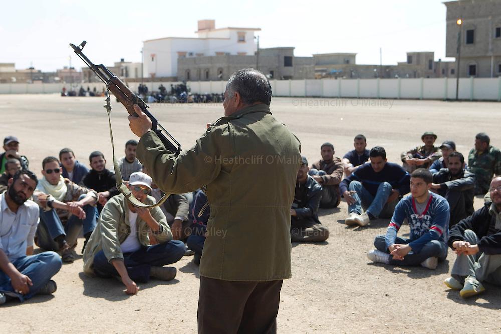 Mcc0030300 . Daily Telegraph..Sgt Sadiq Musrati, 57, instructs rebel recruits at a former Libyan Army base on the outskirts of benghazi...Benghazi 4 April 2011