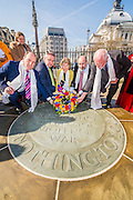 A wreath is laid  at The Memorial for Innocent Victims of war and oppression by Simon Hughes MP, Tim Loughton MP, Kate Hoey MP, Fabian Hamilton MP, and Lord Howarth (L to R) following a short multi-faith service led by Canon Jane Hedges from Westminster Abbey. MPs from the All Party Parliamentary Group for Tibet attended the annual ceremony in memory of Tibetans who have lost their lives since the Uprising in 1959. Westminster Abbey, London, UK 12 March 2014. Guy Bell, 07771 786236, guy@gbphotos.com