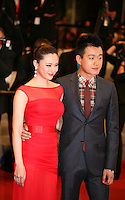 Tong Dawei and Guan Yue arriving at the gala screening of the film Baad El Mawkeaa at the 65th Cannes Film Festival. Thursday 17th May 2012, the red carpet at Palais Des Festivals in Cannes, France.