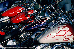 Flames - Parked at the Oasis. Sturgis, SD. 1993<br /> <br /> Limited Edition Print from an edition of 50. Photo ©1993 Michael Lichter.<br /> <br /> The Story: For years, Rat and his buddies parked their flamed choppers seemed to have reserved parking in front of the Oasis Bar. If Rat wasn't sitting watching the crowds right out front, you knew you could find him inside.