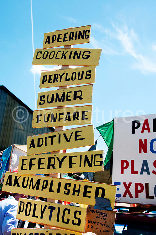 Buxton Street off Brick Lane, East London. June 8th 2014. Vauxhall Art Car Boot Fair. Mis-spelt words by Bob and Roberta Smith aka artist Patrick Brill, selling for £75 - £200, which mock the education policies of the current coalition government and in particular Michael Gove.