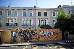 © Licensed to London News Pictures. 23/08/2019. London, UK. Residential properties boarded up as preparations begin in Notting Hill, West London ahead of the 2018 Notting Hill Carnival which starts this weekend. Warm weather is expected over the bank holiday weekend with carnival attracting over 1 million people to the capital. Photo credit: Ben Cawthra/LNP