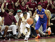 TALLAHASSEE, FL. 12/7/08-FSU-UF MENS HOOPS CH26-Florida State's Toney Douglas chases a steal as Florida's Walter Hodge pursues during second half action Sunday at the Donald L. Tucker Center in Tallahassee. The Seminoles beat the Gators 57-55...COLIN HACKLEY PHOTO FOR NOLEINSIDER.COM