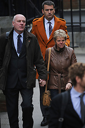 © London News Pictures. 21/11/2011. London, UK.  The parents of the murdered schoolgirl Milly Dowler, L to R Sally Dowler, Milly's mother,  and Robert Dowler, Milly's Father with Mark Lewis, The Dowlers solicitor (rear)  arriving at The Royal Courts of Justice today (21/11/2011) to give evidence at the Leveson Inquiry into press standards. The inquiry is being lead by Lord Justice Leveson and is looking into the culture, and practice of the UK press. The Leveson inquiry, which may take a year or more to complete, comes after The News of The World Newspaper was closed following a phone hacking scandal. Photo credit : Ben Cawthra/LNP