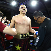 Zhilei Zhang of Zhoukou, China smiles after he defeats Curtis Harper of Jacksonville, Florida during a Nelsons Promotions boxing match at the Boca Raton Resort  and Club on Friday, May 26, 2017 in Boca Raton, Florida.  (Alex Menendez via AP)