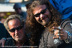 Chris Callen with a friend at the Iron Horse Saloon in Ormond Beach during Daytona Bike Week. FL, USA. March 10, 2014.  Photography ©2014 Michael Lichter.
