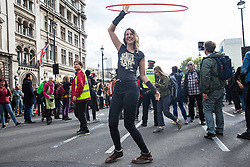 London, UK. 8 October, 2019. Climate activists from Extinction Rebellion block Parliament Street in Westminster on the second day of International Rebellion protests to demand a government declaration of a climate and ecological emergency, a commitment to halting biodiversity loss and net zero carbon emissions by 2025 and for the government to create and be led by the decisions of a Citizens' Assembly on climate and ecological justice.