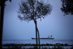"""A ship goes by in Limassol, Cyprus on Feb. 22, 2008. Cyprus is the crossroads of international ship management and  where all the agencies are recruiting and hiring the cheapest workers worldwide. Cyprus is also one of the """"Flag-of-Convenience"""" States like Panama and Liberia."""