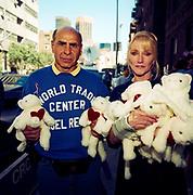 During a journey into America's hinterlands, days after the September 11th attacks in New York and Washington DC, eccentric New Yorkers gather at the city's Armory to offer help and support by handing our fluffy bunnies to passers-by. The streets between 66th and 67th Streets, in the heart of Manhattan's Upper East Side, DNA samples were taken at the Armory so human remains might be identified. It was therefore a point of focus for those with missing relatives who attached thousands of posters to walls with pictures and messages to loved-ones in the hope of being reunited. Emotions were running high and many citizens offered spiritual aide such as food and drink. In outpourings of grief, anger and patriotic rhetoric, flags were flown as never before as  America sought to express their emotions and unity.
