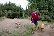 A dog walker exercises his pets on the Beacon, on 15th September 2018, in Malvern, Worcestershire, England UK. Worcestershire Beacon, also popularly known as Worcester Beacon, or locally simply as The Beacon, is a hill whose summit at 425 metres 1,394 ft[1] is the highest point of the range of Malvern Hills that runs about 13 kilometres 8.1 mi north-south along the Herefordshire-Worcestershire border, although Worcestershire Beacon itself lies entirely within Worcestershire.