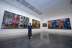 "© Licensed to London News Pictures. 12/04/2021. LONDON, UK. A general view at the opening of Gilbert & George's ""NEW NORMAL PICTURES"" exhibition at White Cube's Mason's Yard gallery in Mayfair. The exhibition displays 26 pictures from a new series the pair have been working on for over two years.  The UK government's coronavirus roadmap out of lockdown has allowed art galleries to reopen today. The exhibition runs 13 April to 8 May 2021.  Photo credit: Stephen Chung/LNP"