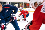 Washington Capitals forward Alex Ovechkin eyes the puck during morning skate at MedStar Capitals Iceplex on September 14, 2019.