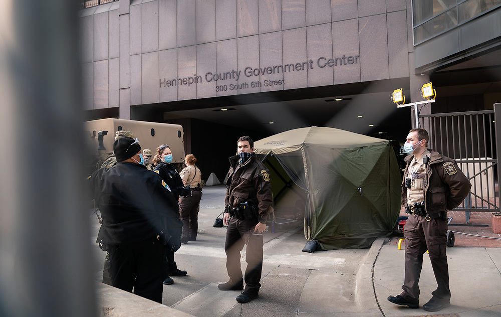 Minnesota Sheriffs and Hennepin County Security line the perimeter of the Hennepin County Government Center, the site of the trial of former Minneapolis Police officer Derek Chauvin in Minneapolis, Minnesota, on Tuesday, March 9, 2021.