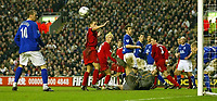 Photo. Aidan Ellis.<br /> Liverpool v Everton.<br /> FA Barclaycard Premiership.<br /> 31/01/2004.<br /> Everton's Tony Hibbert heads the ball of the line from Liverpool's Anthony Le Tallec