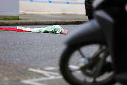 © Licensed to London News Pictures. 04/01/2020. London, UK. A blanket on the road within the crime scene on Charteris Road, near the junction with Lennox Road, Finsbury Park in north London. Police launch a murder investigation following a death of a man in his 30s on Friday 3 January 2020. Police were called at approximately 6.50pm to reports of a man stabbed and the he was pronounced dead at the scene just after 7.30pm.  Photo credit: Dinendra Haria/LNP