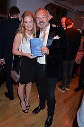Actress SARAH HADLAND and GRAHAM NORTON at a party to celebrate the publication of Holding by Graham Norton held at Liberty, Regent Street, London on 12th October 2016.