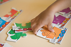 Child doing a jigsaw puzzle,