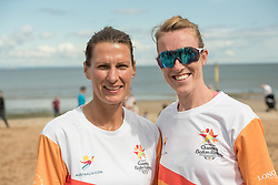 The Commonwealth Games Queen's Baton came to Portobello Beach and it still wasn't the biggest thing happening there. The Big Beach Busk, now in its eighth year was just getting underway when the Baton arrived at the beach volleyball courts by Portobello Baths where a Men's CEV Continental Tour competition was underway. Pictured: Scottish Women's Beach Volleyball Mel Coutts Lynne Beattie<br /> <br /> <br /> © Jon Davey/ EEm