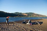 Alfonso Jimenez readies his kite for launch at Hood River, Oregon