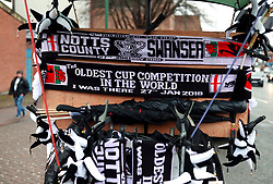 "Half and half scarves for sale outside the ground before the Emirates FA Cup, fourth round match at Meadow Lane, Nottingham. PRESS ASSOCIATION Photo. Picture date: Saturday January 27, 2018. See PA story SOCCER Notts County. Photo credit should read: Mike Egerton/PA Wire. RESTRICTIONS: EDITORIAL USE ONLY No use with unauthorised audio, video, data, fixture lists, club/league logos or ""live"" services. Online in-match use limited to 75 images, no video emulation. No use in betting, games or single club/league/player publications."