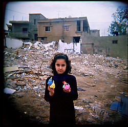 Nour Al-Akhrass holds dolls belonging to her younger cousin who was killed in the conflict between Israel and Hezbollah, Aytaroun, Southern Lebanon, Oct. 23, 2006.
