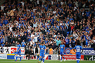 Portsmouth players celebrate Portsmouth forward Jamal Lowe (10) goal in front of their fans during the EFL Sky Bet League 1 match between Peterborough United and Portsmouth at London Road, Peterborough, England on 15 September 2018.