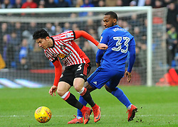 Junior Hoilett of Cardiff City tackles Bryan Oviedo of Sunderland- Mandatory by-line: Nizaam Jones/JMP- 13/01/2018 -  FOOTBALL - Cardiff City Stadium - Cardiff, Wales -  Cardiff City v Sunderland - Sky Bet Championship