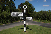A landscape at a junction of two country lanes, with the directions for West Chiltington, Thakeham, Coolham and Dial Post, on 8th September 2019, at Knepp, West Sussex, England.