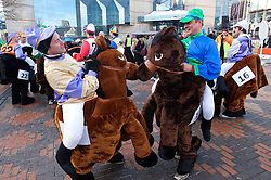 © under licence to London News Pictures 28/11/2010 today picture. Birmingham`s wackiest Christmas event, the annual Pantominme Horse Grand National. The event that sees riders and horses race up and down Broad Street in the City Centre jumping over and even Through straw bales. Pictures shows two horses getting to know each other before the start of the races..Picture credit: Dave Warren/London News Pictures...