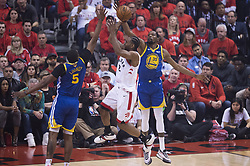 June 11, 2019 - Toronto, on, Canada - Toronto Raptors forward Kawhi Leonard (2) goes to the net against Golden State Warriors forward Kevin Durant (35) and centre Kevon Looney (5) during first half basketball action in Game 5 of the NBA Finals in Toronto on Monday, June 10, 2019. (Credit Image: © Chris Young/The Canadian Press via ZUMA Press)