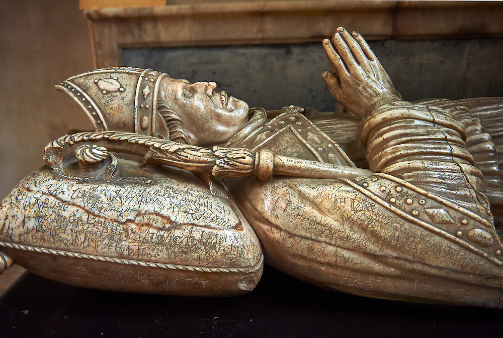 """Tomb of Robert Creyghton, Treasurer of Wells & Bishop 1070-1072 in the medieval Wells Cathedral built in the Early English Gothic style in 1175, Wells Somerset, England . Its Gothic architecture is mostly in Early English style of the late 12th – early 13th centuries. Building began about 1175 at the east end with the choir. Historian John Harvey sees it as Europe's first truly Gothic structure. Its Early English front with 300 sculpted figures, is seen as a """"supreme triumph of the combined plastic arts in England"""".<br /> <br /> Visit our MEDIEVAL PHOTO COLLECTIONS for more   photos  to download or buy as prints https://funkystock.photoshelter.com/gallery-collection/Medieval-Middle-Ages-Historic-Places-Arcaeological-Sites-Pictures-Images-of/C0000B5ZA54_WD0s"""