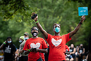 WASHINGTON, DC -- 8/28/20 -- Vanessa Rouse, left and Quinette Smith-Tanner, of Milwaukee react to one of the speakers.<br /> The 57th Anniversary March on Washington drew thousands to the National Mall to hear activists speak at the Lincoln Memorial .…by André Chung #_AC20157