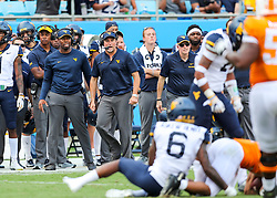Sep 1, 2018; Charlotte, NC, USA; West Virginia Mountaineers head coach Dana Holgorsen reacts along the sidelines during the second quarter against the Tennessee Volunteers at Bank of America Stadium. Mandatory Credit: Ben Queen-USA TODAY Sports