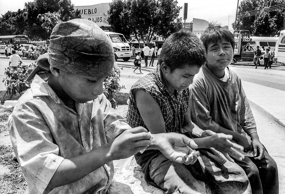 Homeless children living under the railroad tracks, Oaxaca, Mexico