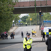 2021-09-09 ExCeL London East Gate, London, UK. Stop the arms fair protestors blockades road by hanging on the bridges, two more lock themselves at the approach road, the East Gate to block the entrance to the military tractor Excel London Arms Fair