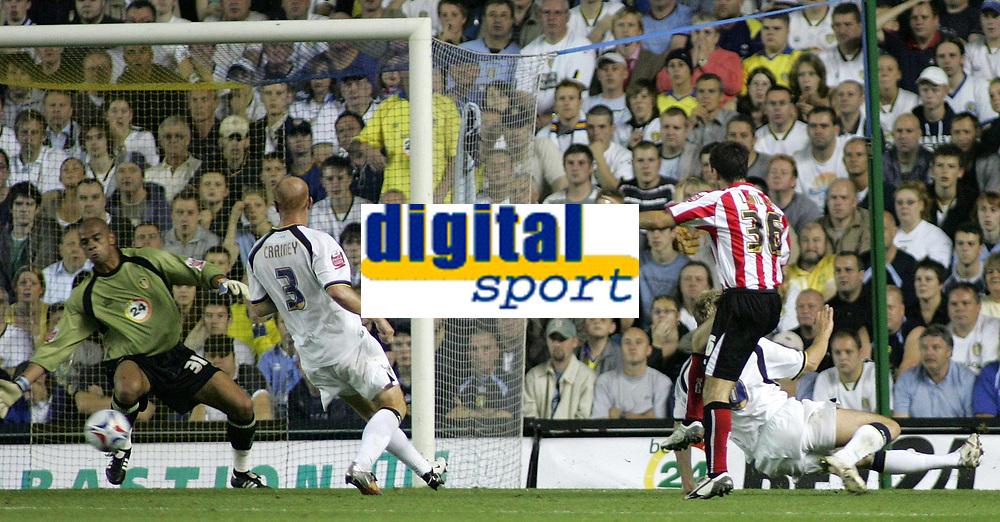 Photo: Paul Thomas.<br /> Leeds United v Sunderland. Coca Cola Championship. 13/09/2006.<br /> <br /> Liam Miller (36) of Sunderland slots home the first goal past Leeds goal keeper Tony Warner (L).