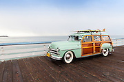 Vintage Woody Car on Display at the San Clemente Pier