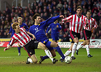Photo. Richard Lane. <br />Southampton v Manchester United. Barclaycard Premiership. 01/02/2003<br />Ruud Van Nistelrooy gets a toe to the ball as Michael Svensson challenges.